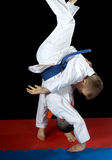 High throw uki-goshi in the performance athlete with orange belt Stock Image