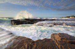 High tide at Coledale rock platform Stock Image