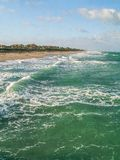 High Tide and Turquoise Green Water at Juno Beach. Evening sun casts shadows and light on the turquoise green water at Juno Beach in Florida royalty free stock photo
