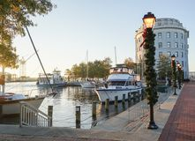 Boats at Portsmouth, VA weather high tide and holiday decoration royalty free stock image