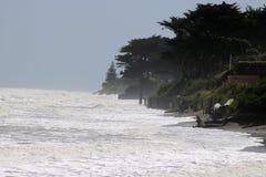 Coastal erosion, high tide, Raumati Beach NZ. A high tide on a windy day 8th November 2017 at Raumati Beach on the Kapiti coast of North Island, New Zealand with Royalty Free Stock Images
