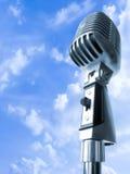 High Time For Rockin!. Vintage Elvis Microphone Over Blue Sky Stock Image