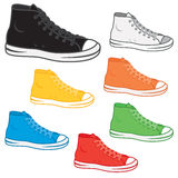 High top sneakers. Generic high top sneakers in a variety of basic colours Royalty Free Stock Photo