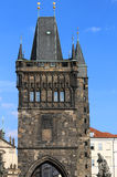High tower with battlements of the Charles Bridge in Prague. Tower of the Charles Bridge in Prague Old Town in Czech Republic Stock Image