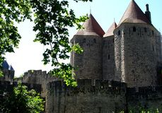 High towers of the medieval fortress Carcassonne,France, Languedoc-Roussillon. High towers and fortifications of the medieval Roman fortress Carcassonne,France Royalty Free Stock Image