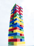 High toy tower of colored blocks Royalty Free Stock Images