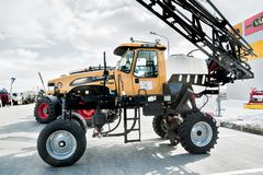 High tractor on agricultural machinery exhibition Royalty Free Stock Photo
