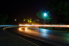 High traffic road with motion blurred automobile. Night Royalty Free Stock Images