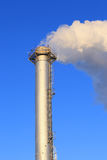 High tube industrial boiler and white smoke Royalty Free Stock Photography
