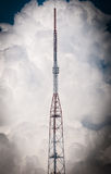 High TV tower and sky with clouds in background. Stock Photos