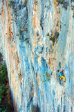 High Unusual Color rocky Wall and two Climbers ascending Royalty Free Stock Photo