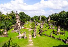 Giant Buddha and Hindu statues in a green park with the view fro. A high up view of a Buddhist and Hinu park in Laos stock photos