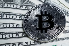 High value Bitcoin Crpto currency coin on US dollar banknotes Royalty Free Stock Photography
