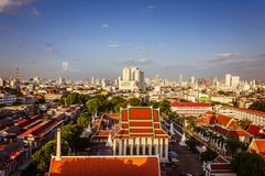 High view on Bangkok under blue sky with white clouds. Spectacular view on the capital city of Thailand, under clear blue sky and small white clouds, private Stock Photo
