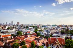 High view on Bangkok under blue sky with white clouds. Spectacular view on the capital city of Thailand, under clear blue sky and small white clouds, private Royalty Free Stock Photography