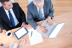 High view of businessmen working together on laptop Royalty Free Stock Photos