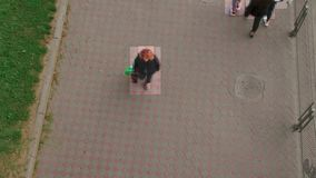 High view camera of people walking. Facial recognition interface scans personal data for each person