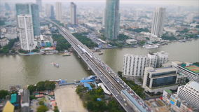 High view of Chaopraya river and transportation by boat. Speed video high view of transportation by boat on Chaopraya river and car on Taksin bridge in Bangkok stock video footage