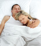 High view of couple sleeping in bed Stock Photography