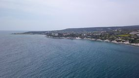 High view from drone on beautiful coastline in cloudy weather in daytime. Amazing blue water stock video