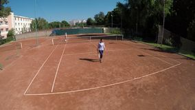High view of friends play tennis at outdoors course arena stock video