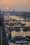High view of the Ijhaven port in Amsterdam. Amsterdam, the Netherlands - August 19, 2015: Sunset view of the crowded Ijhaven port on the 1st day of the SAIL 2015 Royalty Free Stock Images