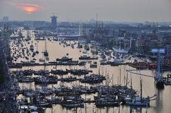 High view of the Ijhaven port in Amsterdam. Amsterdam, the Netherlands - August 19, 2015: Sunset view of the Ijhaven port on the 1st day of the SAIL 2015 (www Stock Photo