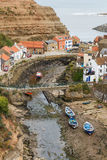 High view looking down onto Staithes Beck and the town. Stock Image