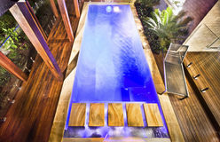 High view of the modern blue water swimming pool Stock Photos