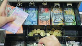 Free High View Of A Shop Assistant Taking Australian Currency From A Cash Register Stock Photos - 132663633