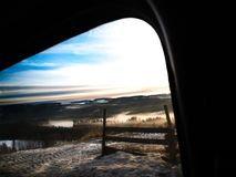 High view over misty sunrise in winter landscape royalty free stock photo