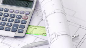 High view of plans, calculator and design objects turning Royalty Free Stock Photos