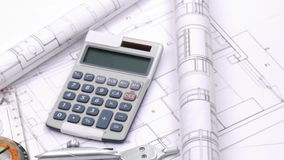 High view of plans and design tools turning Stock Photo