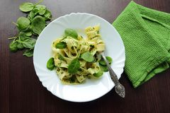 High view on a plate with pasta with spinach sauce Stock Photo