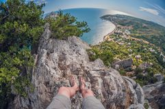 High view from the rocks to the coast and juniper bushes, first-person, fish eye distortion stock images