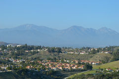 High View of Southern California Inland Suburb. High View of California Inland Suburb in Chino Hills with San Gabriel Mountains Stock Photo
