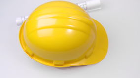 High view of a yellow hard hat and a plan turning stock video footage
