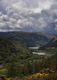 High viewpoint over Glendalough lakes and ancient monastery. Walking the wicklow way giving away the finest of the irish landscapes stock photo