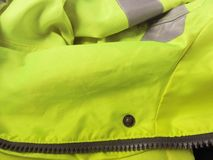 High visibility yellow jacket as background Stock Images