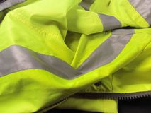 High visibility yellow jacket as background Royalty Free Stock Photo