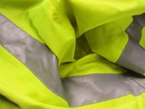 High visibility yellow jacket as background Stock Image