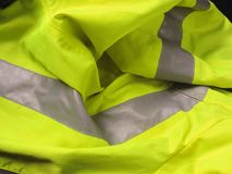 High visibility yellow jacket as background Stock Photos