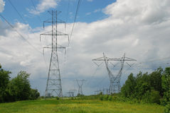 High volatge pylons. Silhouette of a electric high voltage steel pylons Royalty Free Stock Images