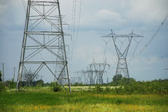 High volatge pylons. Silhouette of a electric high voltage steel pylons Stock Images