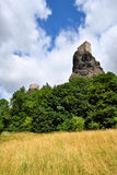 High volcanic cliff with castle towers Stock Image