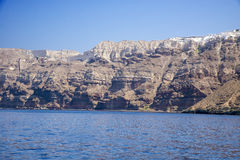 High volcanic cliff in Santorini island Stock Photos