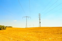 High Voltage. Row Of High Voltage Electricity Pole In Desert Stock Photography