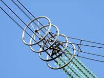 High voltage. Cable in insulator of high-voltage power line Royalty Free Stock Photography