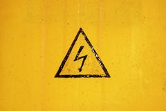 High Voltage. Sign on ragged background Royalty Free Stock Photos