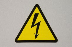 High Voltage. Sign on white metal plate Royalty Free Stock Photo